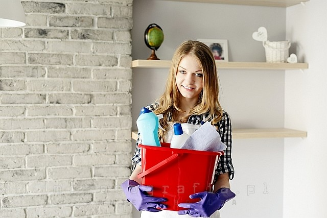 blond woman holding a bucket full of cleaners